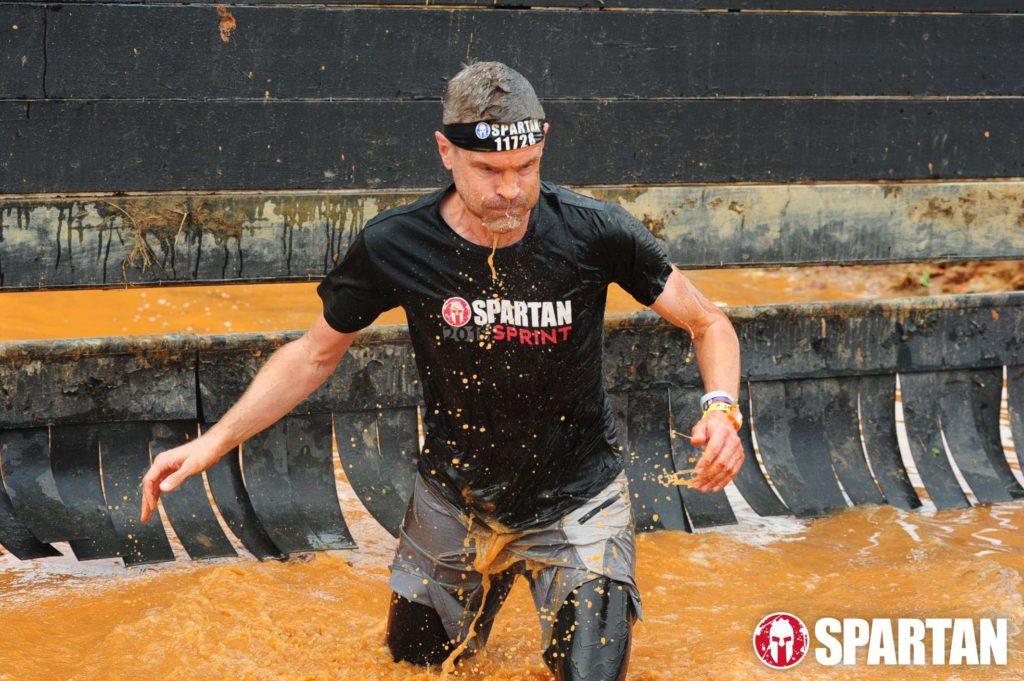 Pastor Joe Burnham running a Spartan Super.